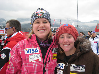 Alice McKennis (l) and Stacey Cook smile in the finish after posting a pair of top 20 finishes in the first of two downhills from Haus im Ennstal (Doug Haney/U.S. Ski Team)