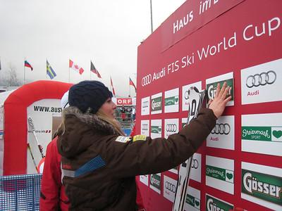 Lindsey Vonn straightens up the leader box after a manget fell off the backdrop (Doug Haney/U.S. Ski Team)