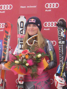 Lindsey Vonn holds her hand over her heart during the U.S. National Anthem after winning the second of two downhill races in Haus im Ennstal. It was the fourth straight DH win for Vonn this season and marked the 27th World Cup victory of her career (Doug Haney/U.S. Ski Team)