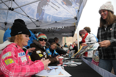 Sarah Schleper greets a fan as U.S. Ski Team athletes sign autographs at the Aspen Winternational, the women's only stop in the USA on the Audi FIS World Cup. (U.S. Ski Team/Tom Kelly)