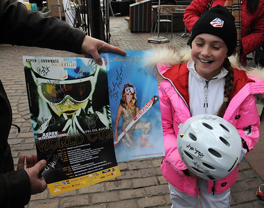A fan shows off her posteres as U.S. Ski Team athletes sign autographs at the Aspen Winternational, the women's only stop in the USA on the Audi FIS World Cup. (U.S. Ski Team/Tom Kelly)