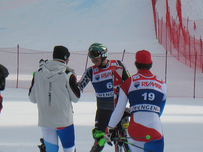 Bode Miller shakes the hand of super combined third place finisher Silvan Zubriggen as Carlo Janka appraoches to congratulate Miller on his victory (Doug Haney/U.S. Ski Team)