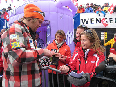 """Steven Nyman hands out """"Believe in Steven"""" buttons to the media following the Lauberhorn downhill (Doug Haney/U.S. Ski Team)"""