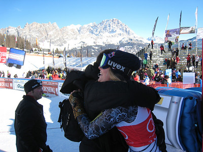 Speed Head Coach Alex Hoedlmoser congratulates Lindsey Vonn after her seventh World Cup win this season with victory in the Cortina super G (Doug Haney/U.S. Ski Team)