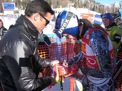 Lindsey Vonn signs a red bib that will be auctioned to raise money for the Haiti earthquake releif effort (Doug Haney/U.S. Ski Team)