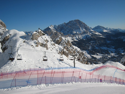 Coaches perched high on the rocks for good sight lines on the Cortina race course (Doug Haney/U.S. Ski Team)
