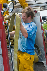 World Cup downhiller Marco Sullivan stores hose in an engine truck as the men's alpine athletes of the U.S. Ski Team train with the Salt Lake City Fire Department. Photo: Tom Kelly/U.S. Ski Team
