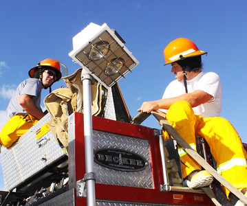 Erik Fisher (r) firefighter training with the SLCFD  Photo: Jay Dyal, Media Specialist, SLCFD
