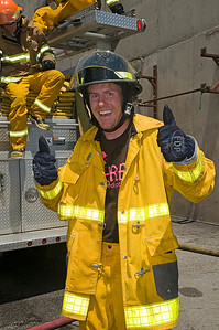 Olympic champion Ted Ligety gives a thumbs up as the men's alpine athletes of the U.S. Ski Team train with the Salt Lake City Fire Department. Photo: Tom Kelly/U.S. Ski Team