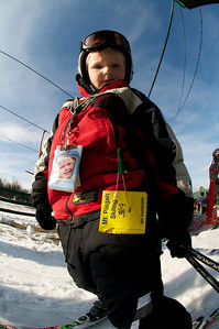 A young skier at Mt. Pisgah in Saranac Lake, NY during a fundraising event to help the Village owned ski area buy a new T-Bar. U.S. Ski Team athletes skied and signed autographs at Mt. Pisgah one day prior to the 2010 Visa U.S. Alpine Championships at nearby Whiteface Mountain (Jon Margolis Photography)