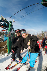 Keely Kelleher (right) boards the lift at Mt. Pisgah in Saranac Lake, NY during a fundraising event to help the Village owned ski area buy a new T-Bar. U.S. Ski Team athletes skied and signed autographs at Mt. Pisgah one day prior to the 2010 Visa U.S. Alpine Championships at nearby Whiteface Mountain (Jon Margolis Photography)