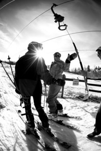 Alice McKennis (right) boards the lift at Mt. Pisgah in Saranac Lake, NY during a fundraising event to help the Village owned ski area buy a new T-Bar. U.S. Ski Team athletes skied and signed autographs at Mt. Pisgah one day prior to the 2010 Visa U.S. Alpine Championships at nearby Whiteface Mountain (Jon Margolis Photography)