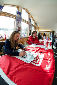 Four-time Olympian Sarah Schleper (l) and 2010 Olympian Will Brandenburg at Mt. Pisgah in Saranac Lake, NY during a fundraising event to help the Village owned ski area buy a new T-Bar. U.S. Ski Team athletes skied and signed autographs at Mt. Pisgah one day prior to the 2010 Visa U.S. Alpine Championships at nearby Whiteface Mountain (Jon Margolis Photography)