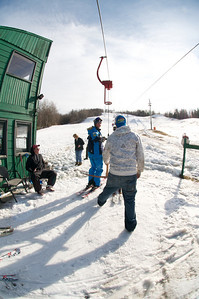 Keely Kelleher boards the lift at Mt. Pisgah in Saranac Lake, NY during a fundraising event to help the Village owned ski area buy a new T-Bar. U.S. Ski Team athletes skied and signed autographs at Mt. Pisgah one day prior to the 2010 Visa U.S. Alpine Championships at nearby Whiteface Mountain (Jon Margolis Photography)