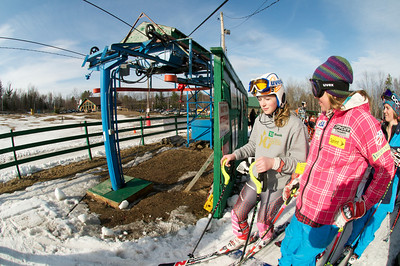 Alice McKennis boards the lift with a local skier at Mt. Pisgah in Saranac Lake, NY during a fundraising event to help the Village owned ski area buy a new T-Bar. U.S. Ski Team athletes skied and signed autographs at Mt. Pisgah one day prior to the 2010 Visa U.S. Alpine Championships at nearby Whiteface Mountain (Jon Margolis Photography)