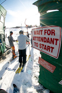 Local skiers board the lift at Mt. Pisgah in Saranac Lake, NY during a fundraising event to help the Village owned ski area buy a new T-Bar. U.S. Ski Team athletes skied and signed autographs at Mt. Pisgah one day prior to the 2010 Visa U.S. Alpine Championships at nearby Whiteface Mountain (Jon Margolis Photography)