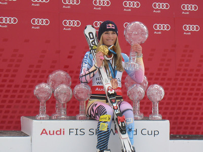 Lindsey Vonn poses with her three World Cup overall globes (08-10), three downhill globes (08-10), two super G globes (09-10) and the 2010 super combined globe and her Olympic downhill gold and super G bronze from Whistler (Doug Haney/U.S. Ski Team)