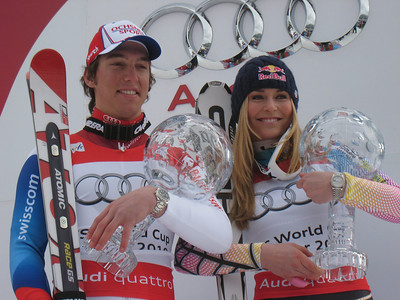 Lindsey Vonn and Carlo Janka pose with the 2010 Audi FIS World Cup overall crystal globes (Doug Haney/U.S. Ski Team)