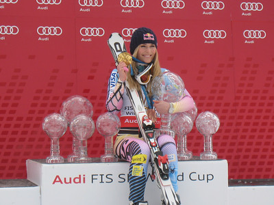 The U.S. Ski Team's Lindsey Vonn shows off her hardward, including Olympic medals and three years of Audi FIS World Cup crystal globes at the World Cup Finals in Garmisch-Partenkirchen, Germany. Vonn won her third straight overall title, along with crystal globes for the downhill, super G and super combined. (U.S. Ski Team/Doug Haney)