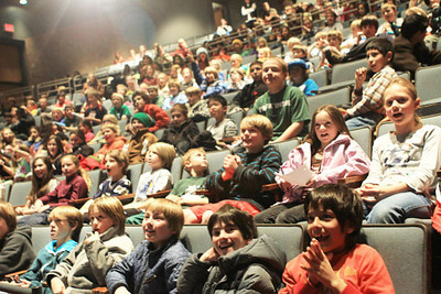 A packed auditorium of youngsters greet Hailey Duke and Kiley Staples in Aspen prior to the Visa Aspen Winternational (Aspen/Snowmass - Heather Rousseau)