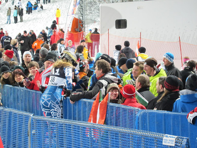 Resi Stiegler hops into the Flachau crowd to meet up with Andy Phillips and Michael Ankeny of the U.S. men's Team (Doug Haney/U.S. Ski Team)