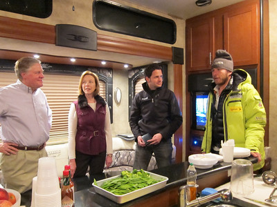 Bode Miller chats with (l-r) U.S. Ambassador to Austria Bill Eacho, his wife Donna and Erik Willemsen of the Associated Press in the U.S. Ski Team mobile nutrition center (Doug Haney/U.S. Ski Team)