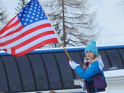A young fan waves the American Flag during the super G podium ceremony in Zauchensee (Doug Haney/U.S. Ski Team)