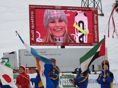 Lindsey Vonn smiles on the big screen in Zauchensee during the downhill podium ceremony (Doug Haney/U.S. Ski Team)