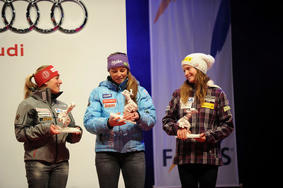 (l-r) Lara Gut, Tina Maze and Julia Mancuso at the awards for women's downhill (Jon Magolis Photography)
