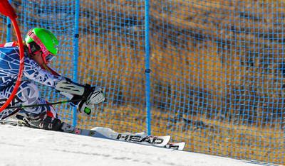 Olympic champ Ted Ligety crashes through a gate as the  U.S. Ski Team trains at Vail's Golden Peak. (c) 2010 U.S. Ski Team/Tom Kelly