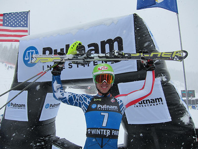 Colby Granstrom raises his Fischer's in victory after topping the men's slalom in snowy Winter Park (Doug Haney/U.S. Ski Team)