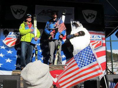 (l-r) Tim Jitloff, Tommy Ford and cardboard Ted Ligety during the National Anthem in Winter Park (Doug Haney/U.S. Ski Team)