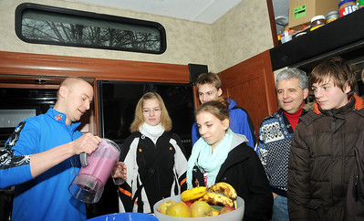 U.S. Ski Team Nutritionist Adam Korzun serves smoothies to a group of German teens from the Garmisch-Partenkirchen area who visited the U.S. Ski Team's mobile food bus during the 2011 FIS Alpine Ski World Championships. (c) 2011 U.S. Ski Team
