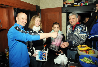 U.S. Ski Team Nutritionist Adam Korzun pours smoothies for a group of German teens from the Garmisch-Partenkirchen area who visited the U.S. Ski Team's mobile food bus during the 2011 FIS Alpine Ski World Championships. (c) 2011 U.S. Ski Team