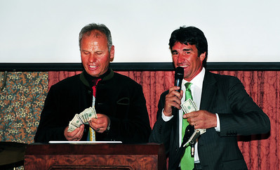 Former pro racers Franz Weber and Andre Arnold jokingly pay each other off but, in the end, donate $1,000 to kick off fundraising for the new World Pro Skiing Foundation as friends gathered at Aspen's historic Hotel Jerome to honor Coach Bob Beattie. (Tom Kelly)