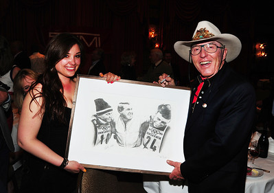 Billy Kidd poses with a sketch of he, Jimmie Heuga and Bob Beattie at the 1964 Olympics as friends gathered at Aspen's historic Hotel Jerome to honor Beattie. (Tom Kelly)