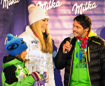 Olympic champion Lindsey Vonn laughs with the event announcer at the opening night bib draw for the Audi FIS Alpine World Cup opener in Soelden. (c) 2011 U.S. Ski Team/Tom Kelly