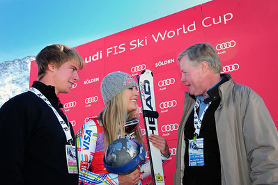 The U.S. Ambassador to Austria William Eacho (rigth) and his son chat with Lindsey Vonn after her historic career first GS win in the Audi FIS Alpine World Cup opener in Soelden, Austria. (c) 2011 U.S. Ski Team/Tom Kelly