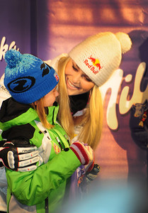 Olympic champion Lindsey Van hugs a young fan at the bib draw for the Audi FIS Alpine World Cup opener in Soelden. (c) 2011 U.S. Ski Team/Tom Kelly