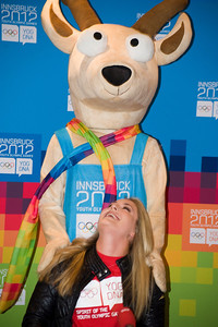 Olympic champion Lindsey Vonn looks up at Yoggl, the mascot of the Youth Olympic Games, during a press conference at Hotel Central before the Audi FIS Alpine World Cup opener in Soelden. (c) 2011 U.S. Ski Team/Tom Kelly