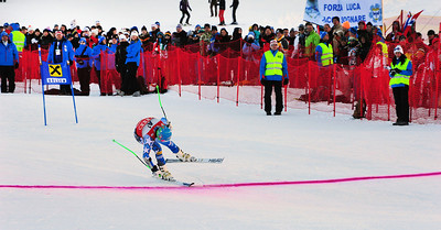 Ted Ligety lunges at the finish line to take the first run lead in the Audi FIS Alpine World Cup opener in Soelden, Austria. (c) 2011 U.S. Ski Team/Tom Kelly