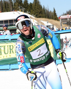 Robby Kelley smiles in the finish after taking the giant slalom title in Winter Park (Winter Sports Photos)