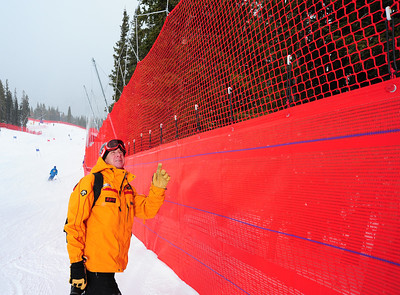 Brad Williams of World Cup Supply checks some of the more than seven miles of neeting at the U.S. Ski Team Speed Center at Copper, with full length downhill training for the U.S. Ski Team. (c) 2011 USSA/Tom Kelly