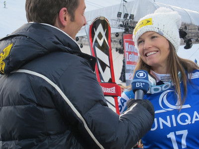 Julia Mancuso interviews with German television after finishing second in the Bad Kleinkirchheim, Austria downhill for her third podium of the season (Doug Haney/U.S. Ski Team)