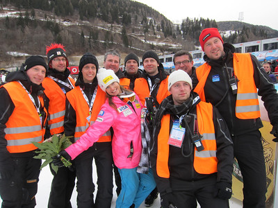 Julia Mancuso poses with volunteers after finishing second in the Bad Kleinkirchheim, Austria downhill for her third podium of the season (Doug Haney/U.S. Ski Team)