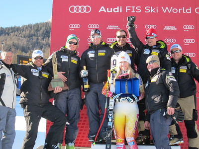 Lindsey Vonn and the U.S. Ski Team coaching staff celebrate after winning the Cortina Trophy for the most successful nation over the two-race series (Doug Haney/U.S. Ski Team)