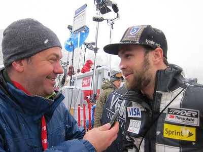 Travis Ganong interviews in the Kitzbuehel finish following his personal best 12th in Kitzbuehel downhill (Doug Haney/U.S. Ski Team)