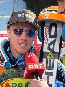 Ted Ligety interviews with Austrian television after winning the Kranjska Gora giant slalom (Doug Haney/U.S. Ski Team)