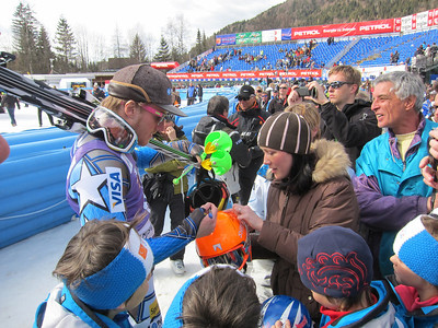 Ted Ligety, who won the Kranjska Gora giant slalom by 1.61 seconds, signs autographs after finishing ninth in the slalom to capture the Vitranc Trophy signifying the fastest racer over the two-day series (Doug Haney/U.S. Ski Team)