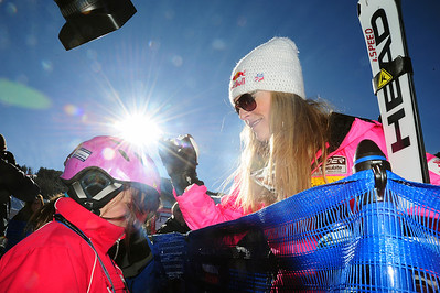 Lindsey Vonn signs an autograph for a fan in the finish area. (U.S. Ski Team/Tom Kelly)